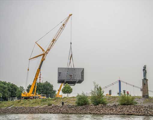 nomanslanding-germany-build-dome-crane-lift--